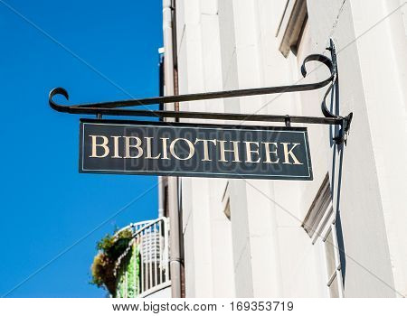 Public library road sign hung on a wall in Amsterdam