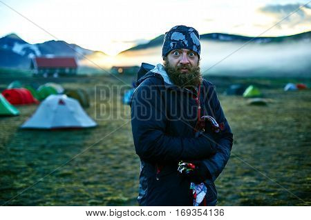 Travel to Iceland. Beautiful sunrise in camping near Alftavatn lake. Icelandic landscape with mountains, sky and clouds. Trekking in national park Landmannalaugar.