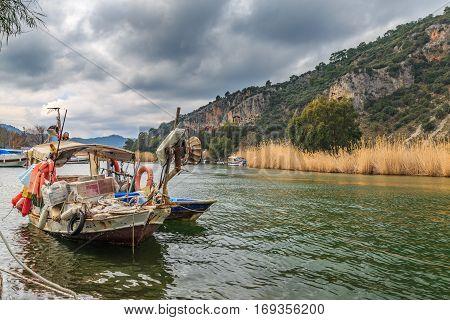 Old fishing boat in Dalyan river in Dalyan Turkey