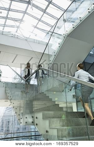 Businesswomen walking on steps in office