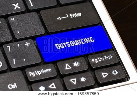 Business Concept - Blue Outsourcing Button On Slim