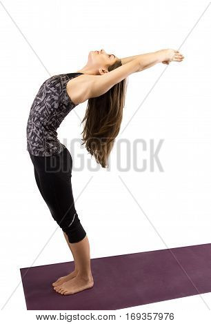Athletic Young Woman Practicing Yoga Pose Isolated On White Background In Studio