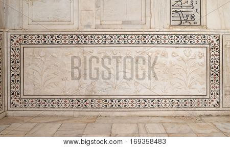 AGRA, INDIA - FEBRUARY 14: Mughal stone art on the facade of the Taj Mahal, an ivory-white marble mausoleum on the south bank of the Yamuna river in Agra, Uttar Pradesh, India on February 14, 2016.