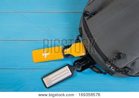 Close Up Of Blank Luggage Tag Label On Suitcase Or Bag With Travel Insurance. Travel Insurance Label