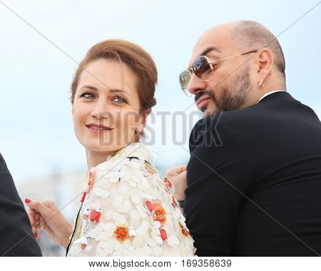 Viktoriya Isakova, director Kirill Serebrennikov  attend the 'The Student' Photocall during the 69th annual Cannes Film Festival at the Palais des Festivals on May 13, 2016 in Cannes, France.