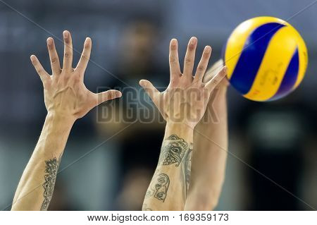 Closeup Of Hands And Ball During The Volleyball Game