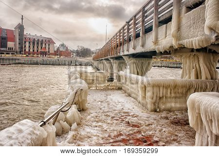ice covered pier on cold gloomy winter day