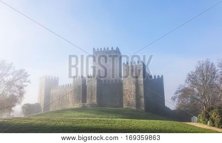 Guimaraes castle in a foggy morning, north of Portugal
