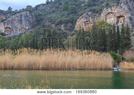 Dalyan kings tombs and river with small boat