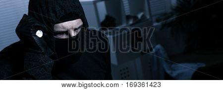 Masked Burglar With Flashlight