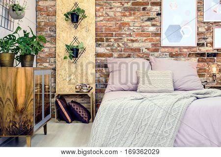 Industrial Bedroom With Pink Bedding
