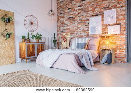 Bright Bedroom With Brick Wall