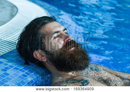 Handsome Man Relaxes In Pool