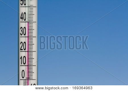 Climate Change Thermometer Gives Indicates Heat in The Atmosphere. Heat Of Summer on a Natural Sky Background.