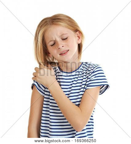 Little girl with pain in shoulder on white background