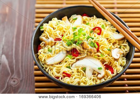 Instant noodles with shiitake mushrooms and vegetables traditional Asian food top view