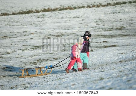 Two Kids Pulling Sledge
