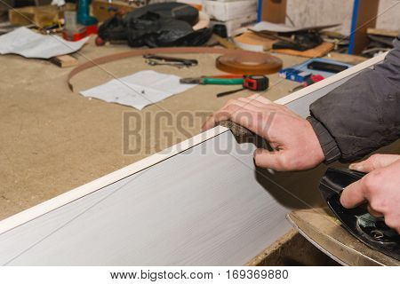 Processing of a wood-shaving plate. Work in the joiner's shop