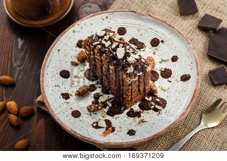 Delicious sweet chocolate Spartak cake on a rustic plate. Haute cuisine dessert. International food. Top view shot.