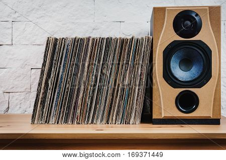wooden shelf full of old vinyl records and speaker