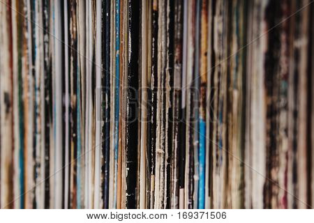 Abstract detail of a shelf full of old vinyl records