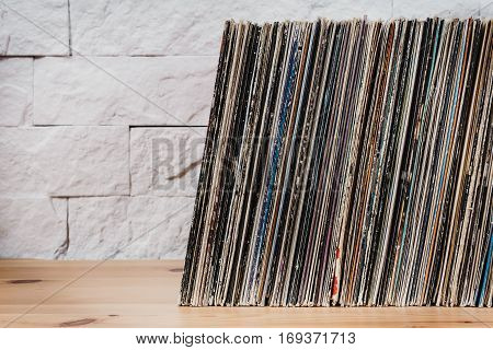 wooden shelf full of old vinyl records