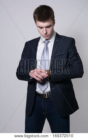Portrait Of Confident Business Man Looking At His Watch