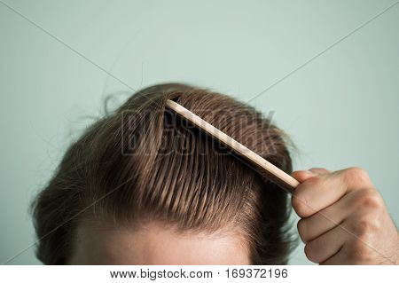 Man With Healthy Hair Holding Comb