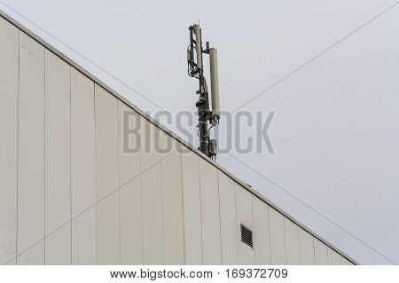 Antenna telecommunications tower on a roof wireless telecommunications concept.