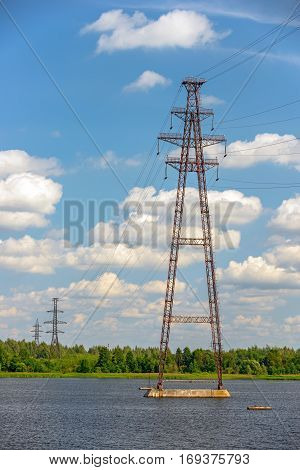 Power lines towers and pylons over river