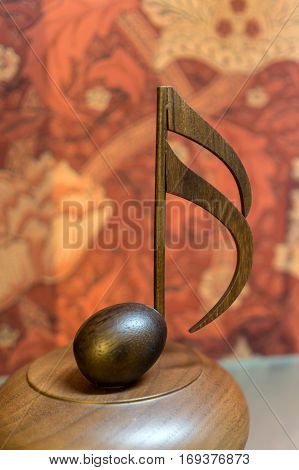 KOBE, JAPAN 2016 Dec18 : Note sign music box on wood pedestal at KOBE music box museum