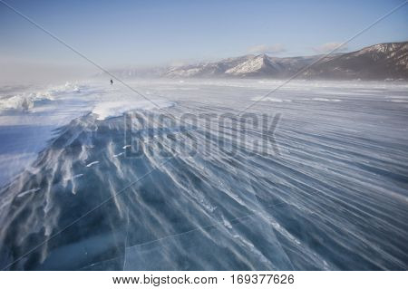 Snowstorm On Ice Of Lake Baikal. Winter Landscape