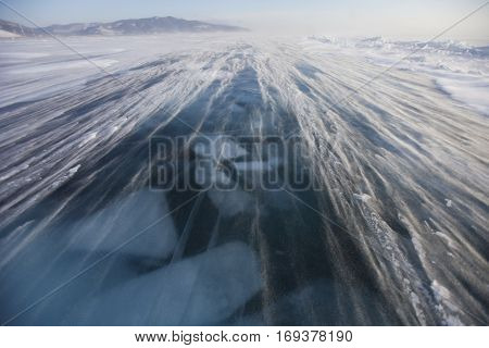 Snowstorm on the ice of Lake Baikal. Winter landscape