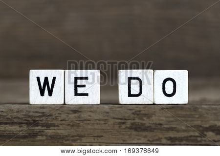 We Do, Written In Cubes On Wooden Background