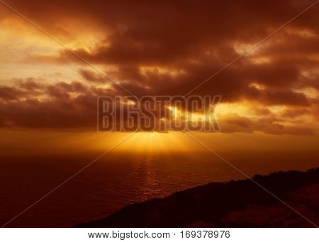 Dramatic red sunset over the Dingli cliffs, Malta