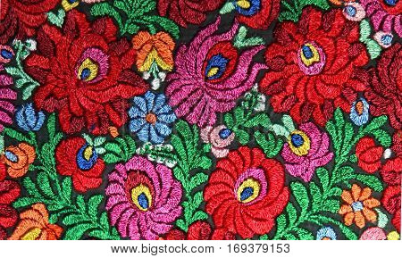 multicolor floral hand embroidery pattern macro image