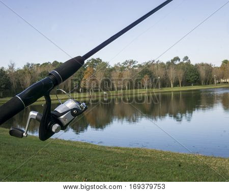 Rod and reel at a pond during the early morning