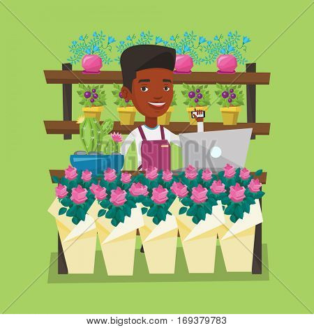 An african-american florist using telephone and laptop to take order. Young florist standing at the counter at flower shop. Man working in flower shop. Vector flat design illustration. Square layout.