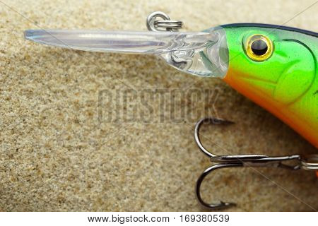 Fishing bait wobbler on a stone sandstone. close up with copy spaсe