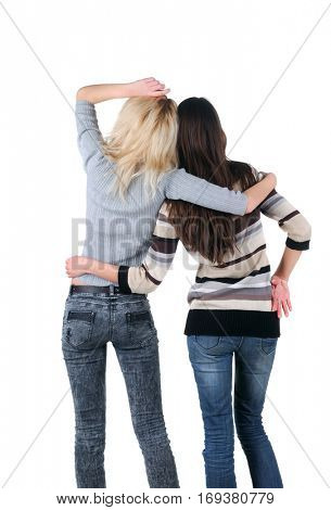 Two women. Rear view. Isolated over white