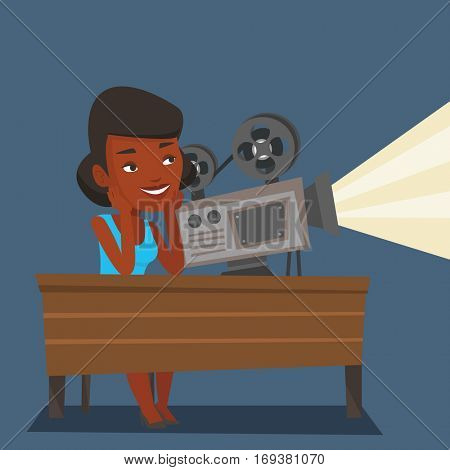An african projectionist showing new film. Woman sitting at the table with film projector in the room of projectionist. Young projectionist at work. Vector flat design illustration. Square layout.