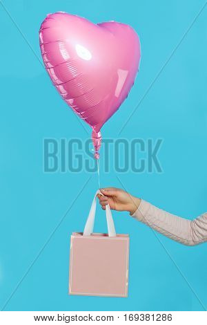 Valentine's Accessorises And Presents. Concept. Ball In The Shape Of A Heart On A Blue Background.