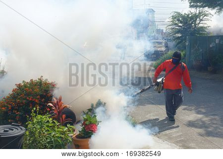 Officers are being injected smoke removal substance mosquitoes sprayer and larvae. To prevent the spread of disease from mosquitoes.