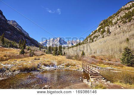Maroon Bells Mountain Landscape With Wooden Bridge.