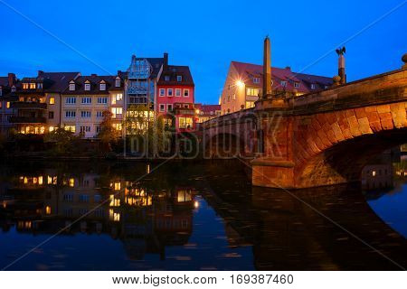 View of Karlsbrucke and Old town of Nuremberg over Pegnitz river at night, Germany