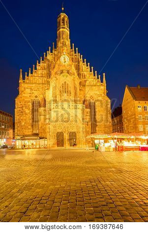 Old town with Nuremberg cathedral church illuminated at night, Germany