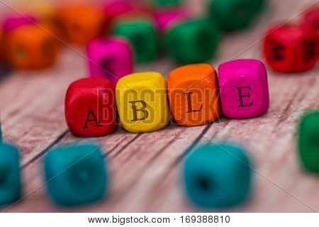 Able  - Word Created With Colored Wooden Cubes. Stock Photo.