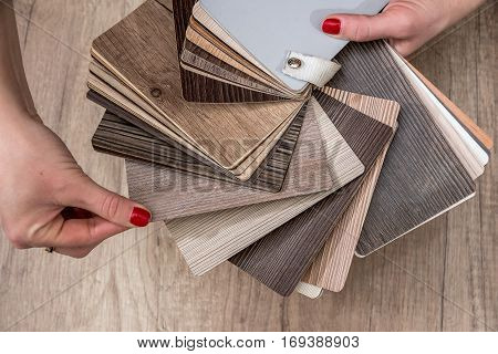 Women Showing Samples Of Laminate And Vinyl Floor Tile