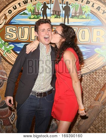 LOS ANGELES - DEC 14:  Adam Klein, Hannah Shapiro at the