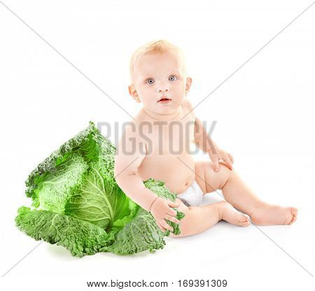 Cute baby with savoy cabbage on white background